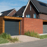 Uitbreiding nieuwbouw huis architect - carport en bijgebouwen